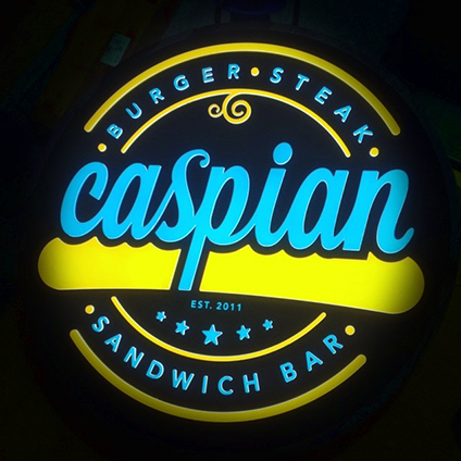 A Back-lit Caspian sign featuring their logo