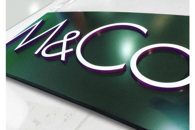 An M&Co sign featuring their logo