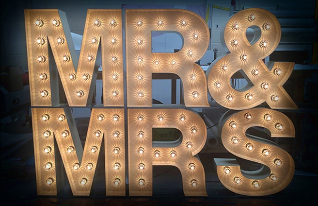 A Mr and Mrs sign consisting of individual, lit-up letters