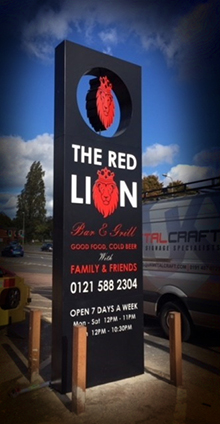 A monolith sign featuring The Red Lion logo embedded on it's own axis, allowing it to spin freely